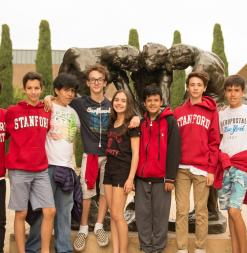 In the Rodin Sculpture Garden, students gather together in front of a famous sculpture.