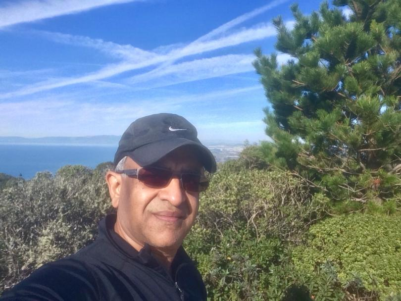 A profile image of Raj Bhargava in a baseball cap appearing to be out in nature